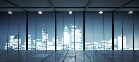 View of a night city from office window Фото со стока
