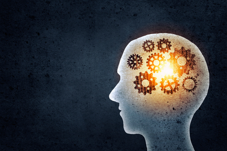 Silhouette of human head with gears mechanism instead of brain Stock Photo
