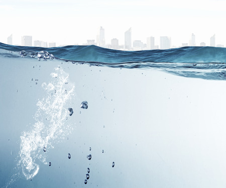 underwater ocean: Underwater image of clear waters and city landscape
