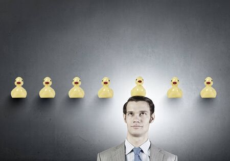 divergent: Funny businessman with yellow rubber duck toy