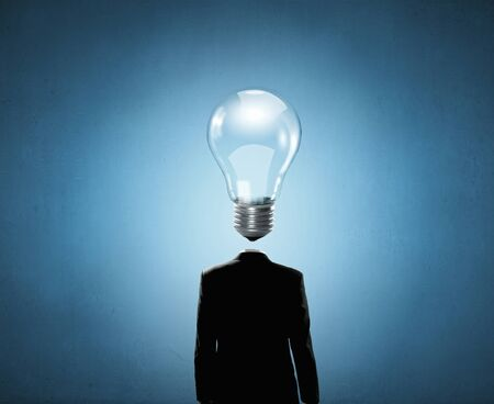 great suit: Businessman with light bulb instead of head Stock Photo
