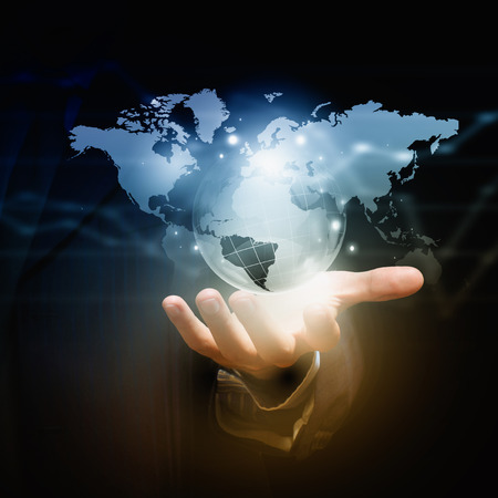 business globe: Close up of businessman hand showing digital planet