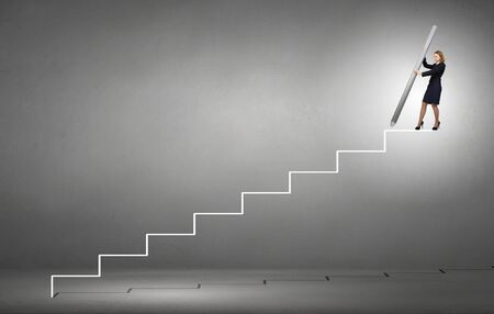 climbing ladder: Businesswoman standing on drawn ladder with huge pencil