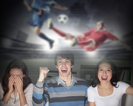 watching football: Young people watching football match on telly