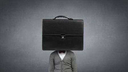joblessness: Unrecognizable businessman with suitcase instead of head Stock Photo