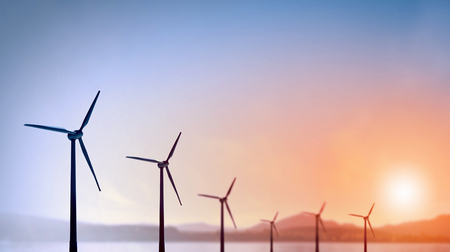 renewable energy: Some windmills standing in desert. Power and energy concept Stock Photo