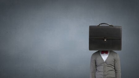 unrecognizable: Unrecognizable businessman with suitcase instead of head Stock Photo