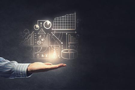 business idea: Businessman hand presenting business idea sketch on palm Stock Photo