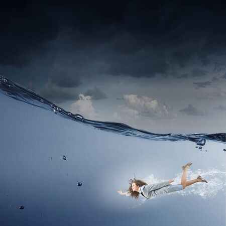 stormy waters: Young businesswoman in suit swimming in stormy waters
