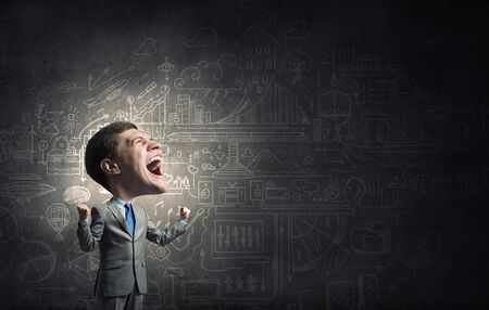 express feelings: Young big headed businessman screaming with his hands up Stock Photo