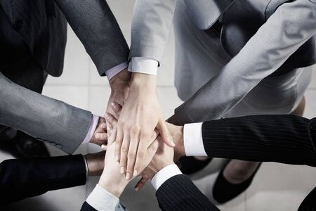 strong partnership: Top view of many businesspeople with hands joined in stack