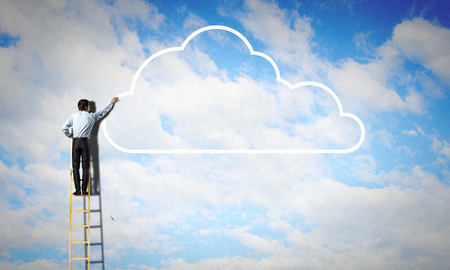ladder: Back view of businessman standing on ladder and reaching to cloud