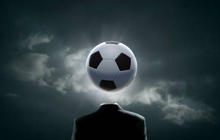 instead: Unrecognizable man with soccer ball instead of head Stock Photo