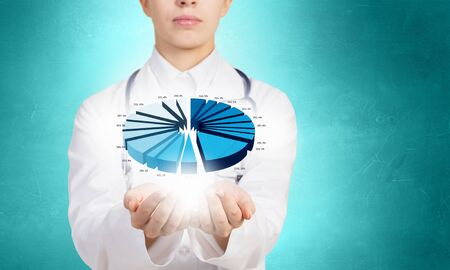 unifrom: Close up of female doctor holding diagram in hands