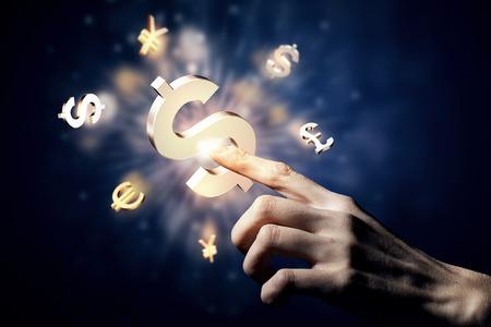 手の指でお金の通貨記号に触れる 写真素材