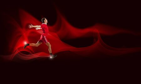 sport wear: Running man in red sport wear on red background Stock Photo