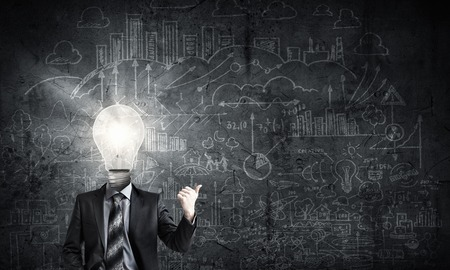 men ideas: Idea concept with businessman and light bulb instead of his head