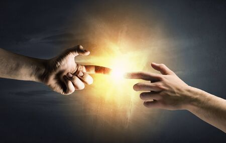 hands reaching: Close up of human hands reaching each other with fingers