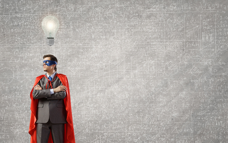 powerful creativity: Young man in superhero costume representing creativity concept