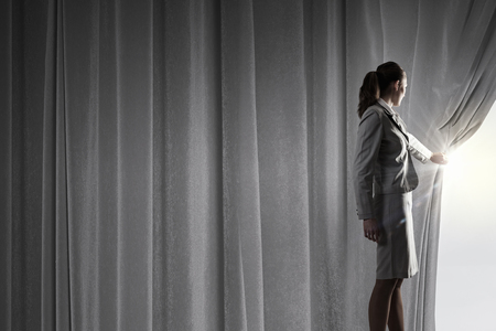 curtain: Businesswoman opening curtain to new ways and opportunities