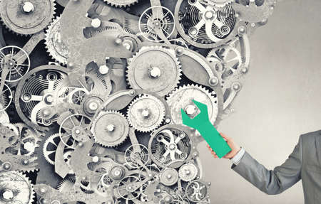 power wrench: Gears and cogwheels mechanism in hands of businessman Stock Photo