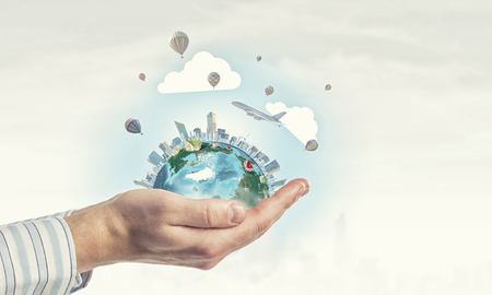 green world: Close up of human hands holding Earth planet.  Stock Photo