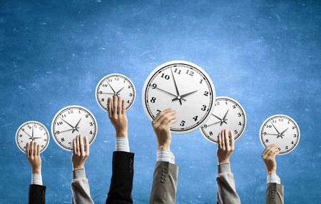 many hands: Many hands of business people holding alarm clock