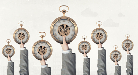 many hands: Many hands of business people holding pocket watch