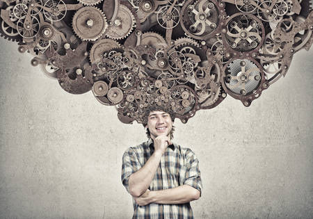 mechanisms: Thoughtful guy with gear mechanisms above his head