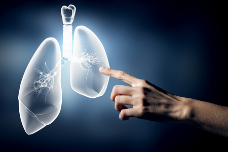 health concern: Close up of hand touching lungs sign