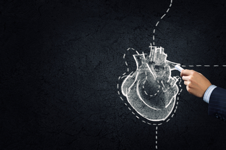 coronary artery: Hand drawing human heart with chalk on black