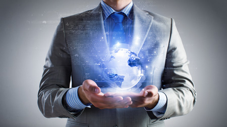 business globe: Close up of businessman holding digital globe in palm