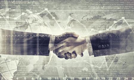 stretta mano: Primo piano di business handshake su sfondo digitale Archivio Fotografico