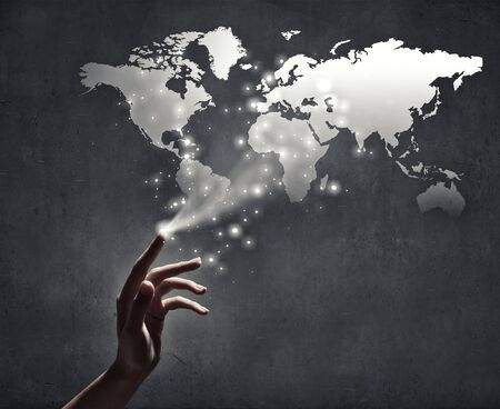 creation: Close up of human hand touching with finger world map