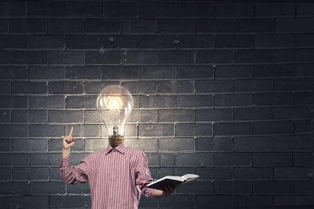 broaden: Unrecognizable businessman with light bulb instead of head