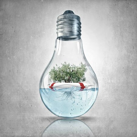 natural energy: Glass light bulb with green tree inside