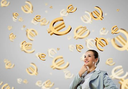 corporate greed: Image of thoughtful businesswoman with euro symbol. Currency concept Stock Photo