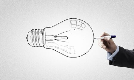 jot: Close up of businessman drawing idea light bulb Stock Photo