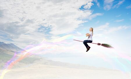 hag: Happy young woman flying in sky on broom