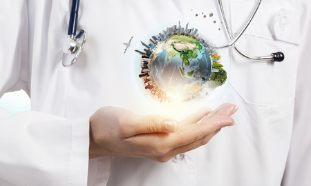 Close up of female doctor holding Earth planet in hands. Elements of this image are furnished by NASA Stok Fotoğraf