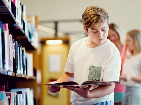 choosing: Boy in library choosing books