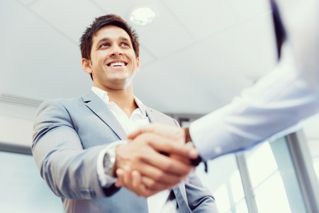 the human hand: Handshake of businessmen greeting each other