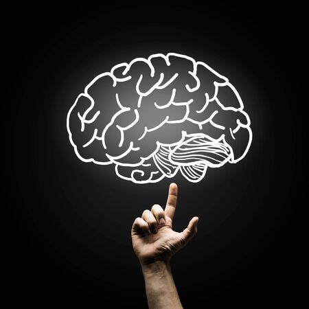 healthy brain: Human hand pointing with finger at brain icon Stock Photo