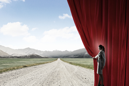 new opportunity: Businesswoman opening curtain to new roads and opportunities Stock Photo