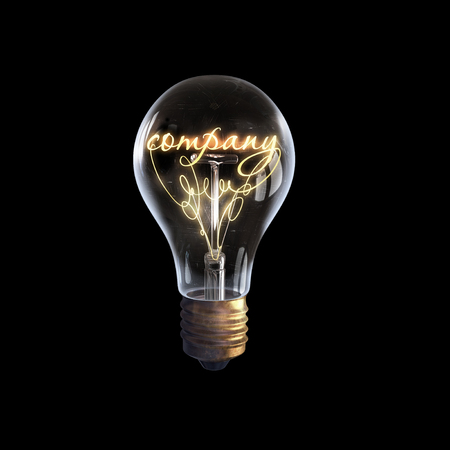 electricity company: Glowing glass light bulb with word company inside