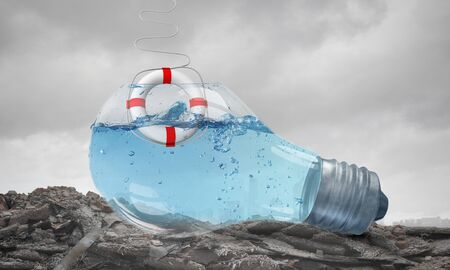 buoy: Glass light bulb filled with water with floating life buoy Stock Photo