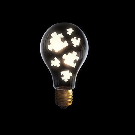 brain puzzle: Glass light bulb with puzzle elements inside