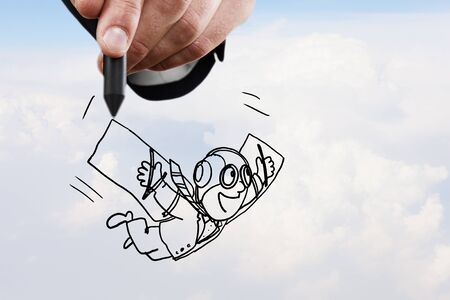 man flying: Conceptual image of contented man with wings flying in the clouds