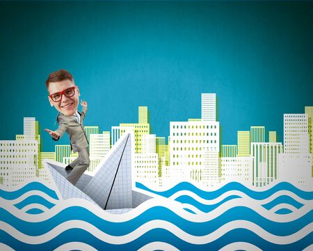 risky job: Businessman escapes from the crisis on paper boat