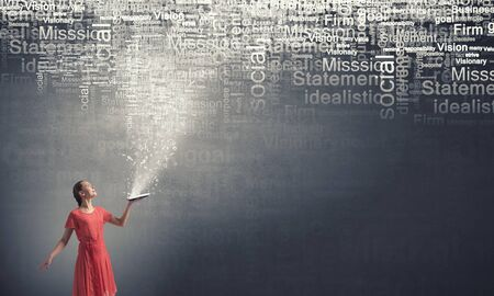broaden: Young woman in red dress with book in hand